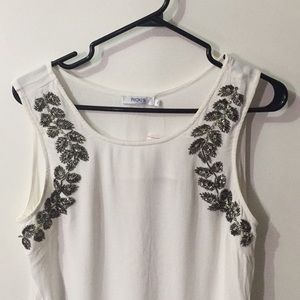 Blouse with beads.